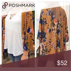 Boho Chic Fringed Kimono 🎉HP🎉 Beautiful trendy mustard color Kimono with gorgeous blue flowers trimmed in a soft olive faux suede fringe. 96% polyester 4% spandex.. Small (2-4) medium (6-8) large (10-12) although i do feel these may run a tad big. The small def fits a size 6. MSRP is $49. Tops Tunics