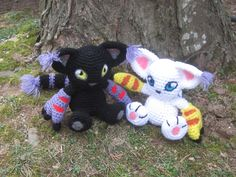 Digimon Inspired:  Gatomon or Blackgatomon by TheTallGrass on Etsy  Handmade plushie (in crochet Amigurumi style) of the beloved cat Digimon, Gatomon!  Gatomon measure roughly 9.5in long 6in tall. Her eyes and detailing are needle-felted and her ears and tail tips are fluffed out yarn.
