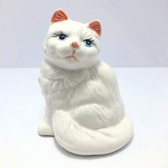 A pretty porcelain kitty made in Japan looking for her forever home! ⚪️⚪️⚪️⚪️⚪️ Dimensions Height: 5.5 Width: 4.5 ⚪️⚪️⚪️⚪️⚪️⚪️⚪️⚪️⚪️⚪️⚪️ Very good vintage condition. Has one small chip on front by paws. Please see pictures. ⚪️⚪️⚪️⚪️⚪️⚪️⚪️⚪️⚪️⚪️⚪️ I am very passionate about collecting and Made In Japan, Carnival Glass, Vintage Ceramic, Vintage Beauty, Kitsch, Handmade Items, Porcelain, Mid Century