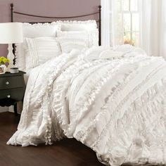 """Four-piece ruffled comforter set.  Product: Comforter, bedskirt and 2 pillow shamsConstruction Material: 100% PolyesterColor: WhiteFeatures: Layered ruffles  Dimensions: Queen Comforter: 90"""" x 92""""King Comforter: 92"""" x 104""""California King Comforter: 92"""" x 104"""" Note: Shams do not include insertsCleaning and Care: Dry clean"""