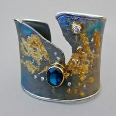GOPH STUDIOS - SIMPLY COOL This hand-fabricated collection sets colored gemstones and diamonds in a dance among sterling silver and 18k gold. Crafted by forcing an ingot through a rolling mill until natural cracking occurs, each fissure becomes a focal point--complimented by hand-hammered texture and 18k gold overlays.