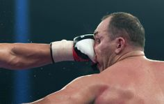 The Heavyweight Champion Kubrat Pulev (Bulgaria) socks the face of Alexander Ustinov (Belarus) during the fight for the title of the art in Hamburg, Germany.