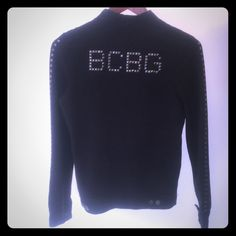 Authentic BCBG Studded Zip Up The first pic is the back. Studs on back and down the arms,  its a zip up thin sweatshirt material  2 button pockets and button closure at the top and bottom of zipper and on sleeves with a zipper on sleeves. Only wore once, in perfect condition! BCBG Sweaters
