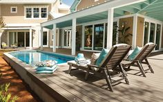 Loving this look! This pool blends seamlessly into its surroundings, with coping aligned flush with composite decking. Beachy blue accents play off the home's coastal style, making the pool area flow with the home's interior. Above Ground Pool Decks, In Ground Pools, Outdoor Spaces, Outdoor Living, Kleiner Pool Design, Small Pool Design, Backyard Renovations, Small Pools, Pool Designs