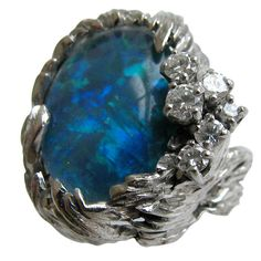 GILBERT ALBERT An Opal Diamond and Gold Ring   From a unique collection of vintage cocktail rings at https://www.1stdibs.com/jewelry/rings/cocktail-rings/