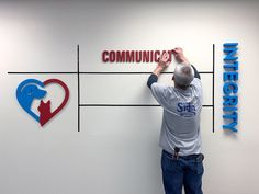 Mission Statement Wall Sign Install | Woodland Manufacturing