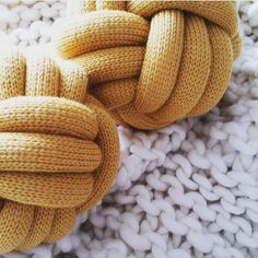 Our previously sold out knot cushions are back! All hand knitted and available in mustard, grey, white and pink these are a fabulous addition to your little ones room and great for just snuggling up to! Knot Cushion, Knot Pillow, Colourful Cushions, Stylish Baby, Baby Essentials, Merino Wool Blanket, Little Ones, Nursery Decor, Hand Knitting