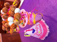 """Whimsical birthday breakfast for kids- Donut holes imitating cake pops. """"Planted"""" in colorful breakfast cereal."""