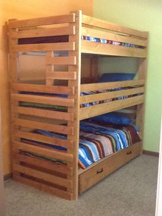 Triple bunk bed with trundle.