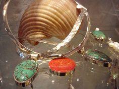 silver collars with silver pendants with semi precious stones