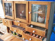 In addition to housing chickens, the dresser can be used to store other goods in its assorted drawers.