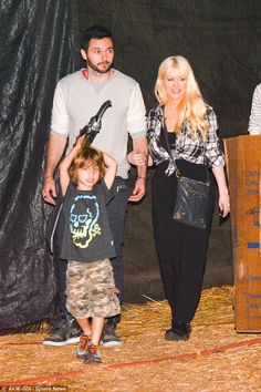 Family time: The singer with her husband-to-be Matthew Rutler and son Max...