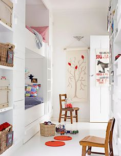 children room with white basic , build-in bunk bed and a little bit of colourful accessories