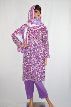 Aziza Women's Perahan Tunbaan.   Stylish and comfortable women's style salwar kameez, or perahan tunbaan. Made from a soft, light weight, and floral fabric. The style fits loosely, making it a modest, knee length style. Comes with matching pants and head scarf. Typically worn by Muslim women in Afghanistan, Pakistan, and countries in South East Asia. Available in the following sizes: Small, Medium, and Large (out of stock).  Color: Purple  Price: $39.99 Product ID: 3AUG13AZIZA