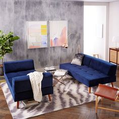 Low-slung and loungy. Our Retro Tillary® 2-Sofa Sectional is lofted on angled solid oak legs in a Pecan finish for a mid-century look. Its weighted, movable back cushions let it seamlessly swing from sofa to chaise to sectional.