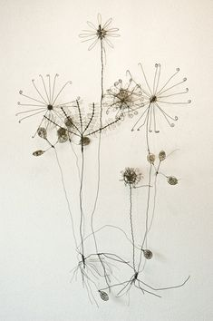 Wire Sculpture by Ben Coutouvidis Why are dandelions all the rage right now?