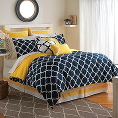 The Hampton Links Reversible Comforter Set combines modern style and easy comfort. It features a link design in yellow and navy that brings style and versatility to your bedroom.