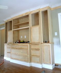 """Custom paint grade built-ins for master bedroom of 1940s house in the  Rice Village area that we are doing some major trim & cabinet upgrades in at the moment.  We built all of the boxes, doors & drawers in the shop & assembled them on site.  10 feed wide x 8 feet tall.  20"""" deep at the lower / center / drawer section.  Steps back to 16"""", then 12"""", which creates some simple visual interest at the crown and the base."""