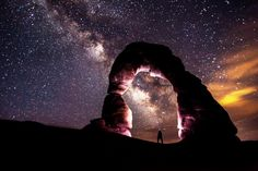 The Delicate Arch Forges Through The Night