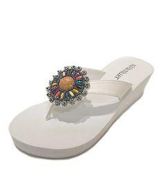 Look what I found on #zulily! White Medallion Wedge Flip-Flop by OLIVIA MILLER #zulilyfinds