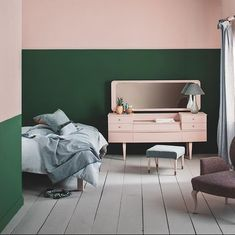 My pink and green mid-century bedroom brings together deep Amsterdam Green and Antoinette. I've blocked the colours to raise the height of the walls. The sweet vintage dressing table is painted with Antoinette, which pops against the Amsterdam Green on the wall. The floor is painted in in Paris Grey a lovely neutral. The curtains, upholstery and soft furnishings are made from fabrics in my Coloured Linen collection.