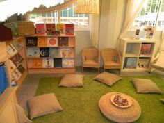 I like the large space this reading area has. I also like how chairs and pillows are providing for seating in the area, along with three shelves for books. Classroom Layout, Classroom Design, Future Classroom, Classroom Decor, Preschool Reading Area, Preschool Rooms, Play Spaces, Learning Spaces, Kid Spaces