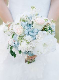 One of our favorite things about this bouquet captured by Tracy Enoch Photography is all the different sized florals from very large to quite small. Don't be afraid to mix and match! See the wedding this bouquet belongs to here.