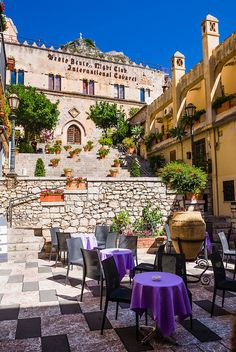 Taormina, Palazzo Ciampoli on Corso Umberto, the main street in the centre of Taormina, Sicily, Italy, Europe. Palazzo Ciampoli has a very popular cafe and is a great place to people watch as tourists walk along Corso Umberto. Copyright © Matthew Williams-Ellis, Wellis Photography
