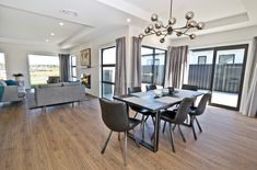 Spacious Dining & Living Room | Feature Lighting | Pendant Light | Wooden Floors | Neutral Room Light Wooden Floor, Dining Room Inspiration, Wooden Flooring, New Homes, Dining Table, Living Room, Interior Design, House, Type 3