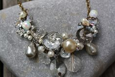 Kathy Cretelle at  25thhourcreations, a respectfully repurposed necklace of vintage elements and beads.