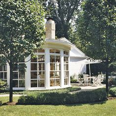 My dream home would have lots of areas for plants to thrive, indoors and out. This sunroom has an old fashioned look I like.