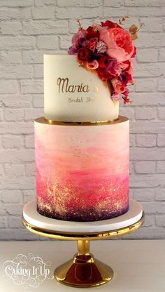 Stunning bridal shower cake features watercolor and metallic gold accents along with beautiful matching flowers. Would be great for a wedding too!