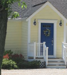 Front Door Color Significance Front Door Color Symbolism Front Door Color For Dark Blue House Grabbing Attention At The Front Door How To Pick A Door Color Paint Colors For Home, Yellow Houses, House Paint Exterior, House Painting, Yellow House Exterior, House Doors, House Front Door, Painted Front Doors, Exterior House Colors
