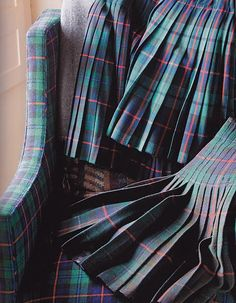 Plaid stitched down pleated skirts.