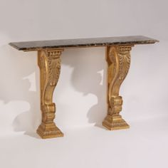 Neoclassic style carved wood console with distressed goldleaf finish and brown emperador marble top. Made in Italy.
