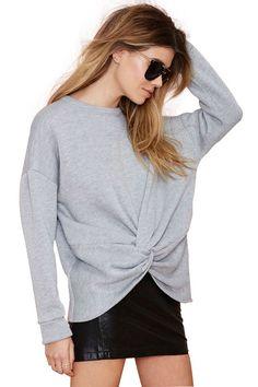 gray knot sweatshirt + floral midi skirt + clogs