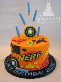 NERF fondant covered birthday cake. Confetti cake with strawberry buttercream and white chocolate ganache frosting.