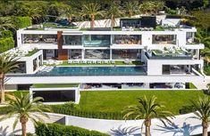 FOR SALE: $250Million!!! (this is not a rendering) 924 Bel Air Road, Bel Air, CA: This insane modern mansion is currently the most expensive home in the United States. The home has over 38,000 square feet of interior living space, plus an additional 17,000 square feet of outdoor living space, all with 270-degree unobstructed views of the mountains, the Pacific Ocean, and the Los Angeles skyline. It features 12 oversized bedrooms, 21 bathrooms, 3 kitchens, 5 bars, a massage room, spa, sta...