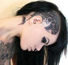 Huge predatory fish head tattoo