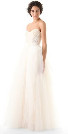 This would be my wedding dress. I love the floaty feel of the tulle and the satin gives it a dress-up look. Showing off the shoulders gives it a sexy appeal. The sequined appliques on the fitted bodice give it shine and therefore make it most appropriate for a night time wedding as well.
