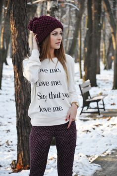 The Cardigans lyrics on a sweater.  I see what you did there.  Cute pants too, but I hate that hat.