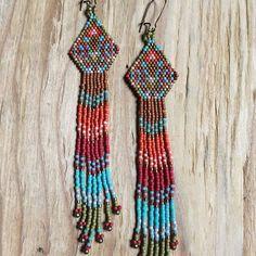 :: Brighid :: seed bead earrings :: Available in my etsy shop  #interwovenbeadworkdesigns #beadwork #earrings #beadedearrings #jewelry #goddess #seedbeads #miyuki #beads #tribal #longearrings #boho #bohemian #miyukiseedbeads #etsyshop #gypsyjewelry #southwest #geometricjewelry #fringeearrings #seedbeadjewelry #fashion #ooak #beader #woven #brickstitch #handmade #handmadeearrings #madewithlove #women #womensfashion