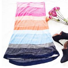"""Missoni Sport Colorful Midi Skirt This skirt has a bright & colorful striped pattern on slinky fabric. It's figure hugging & the length of a midi style skirt. {actual color of item may vary slightly from photos}  •waist: stretchy/15""""•hips:20""""•length:27""""  Material:100%viscose ️️️️️️️️️️️️️️️️️️️️️Dry clean   Fit:tag says 46 fits like medium Condition:no rips no stains  ❌no holds ❌no trades ♥️️bundles of 3/more items get 20% off Missoni Skirts Midi"""