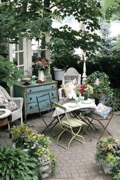 This is just lovely, love the use of indoor furniture out of doors.