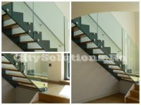 Interior stairs with two side stringers to support the steps of wood, metal or glass. Interior stairs made of painted steel.