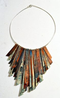 WOW! The earth tones in this are amazing. I love the layering of colors on the individual pieces of canvas, and the layering of the pieces themselves. From AMiRAjewelry.