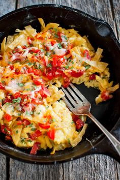 Easy Tex-Mex Migas - Eggs scrambled with tortillas Tex-Mex style with jalapeños, green onions, and white onions for added flavor. A generous helping of cheese makes it extra good. Egg Recipes, Brunch Recipes, Mexican Food Recipes, Cooking Recipes, Mexican Breakfast Recipes, Drink Recipes, Recipies, Savory Breakfast, Breakfast Dishes