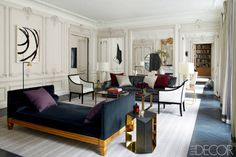 A glamorous apartment in France. I love the smart furniture layout in this long and spacious living room.