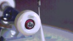 Spinning a skateboard wheel so fast the centrifugal force rips...