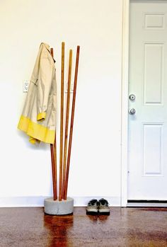This cool industrial coat rack won't take much time or materials and looks very original! It's not typical and great for any modern or industrial hallway. You'll need just 5 broomsticks and a bag of redi-mix concrete. For this base, 30 pounds (or half of a 60 pound bag) was used. Mix the concrete with...